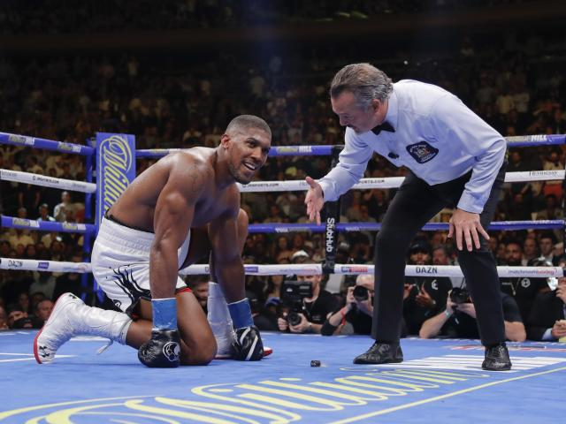 Anthony Joshua waits during the referee's count after he was knocked down during the seventh round of a heavyweight championship boxing match against Andy Ruiz on Saturday, June 1, 2019, in New York. Ruiz won in the seventh round. (AP Photo/Frank Franklin II)