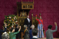 Queen Maxima and members of parliament stand for a triple salute to Dutch King Willem-Alexander after he marked the opening of the parliamentary year with a speech outlining the government's budget plans for the year ahead at the Grote Kerk, or Sint-Jacobus Kerk, (Great Church or St. James' Church) in The Hague, Netherlands, Tuesday, Sept. 21, 2021. (AP Photo/Peter Dejong)