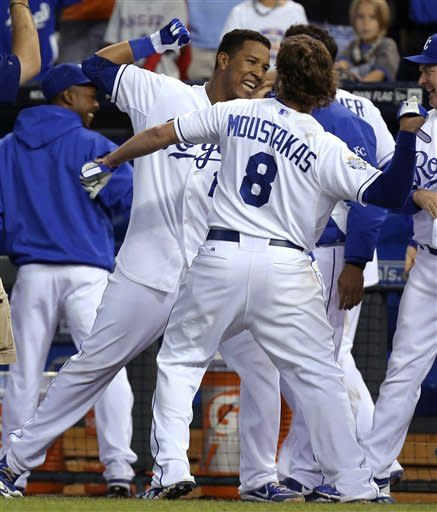 Kansas City Royals' Salvador Perez (13) celebrates his game-winning home run with Mike Moustakas (8) after a baseball game against the Los Angeles Angels on Saturday, Sept. 15, 2012, in Kansas City, Mo. The Royals won 3-2. (AP Photo/Ed Zurga)
