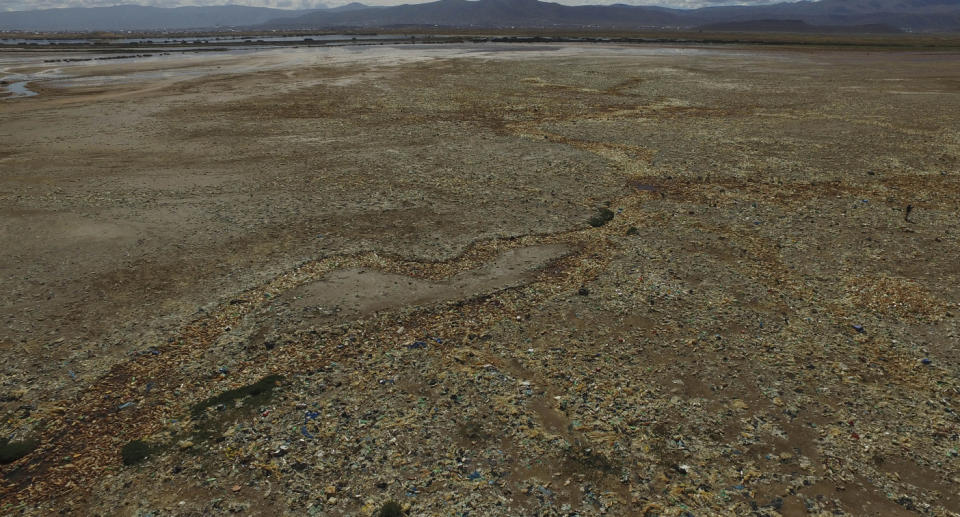 Plastic bottles and other garbage cover a dried-up part of Uru Uru Lake near Oruro, Bolivia, Thursday, March 25, 2021. (AP Photo/Juan Karita)