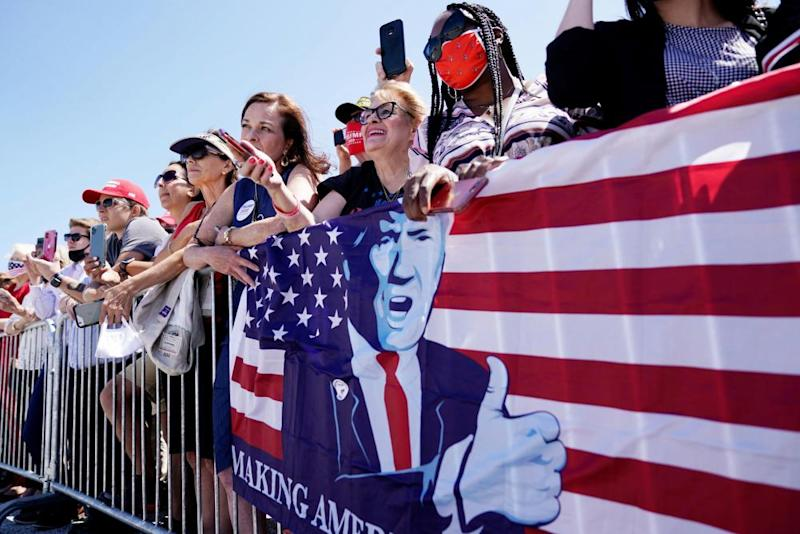 Supporters of Donald Trump listen to him speak during his arrival at Burke Lakefront airport in Cleveland, Ohio, on 6 August.