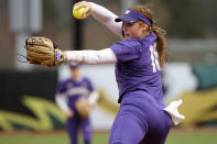 FILE - Washington's Gabbie Plain pitches during an NCAA softball game against Oregon in Eugene, Ore., in this Saturday, March 23, 2019, file photo. Division I softball is providing a training ground this season for players preparing for the 2021 Olympics. Gabbie Plain is a finalist for a slot on Australia's team. (AP Photo/Chris Pietsch, File)