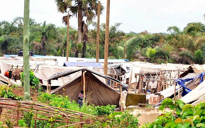 People go about their business at a camp of Ivorian refugees in the Ghanian town of Ampan, in 2011 (AFP Photo/Sia Kambou)