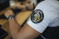 A police officer works in the police station in the Paris suburb of Sarcelles, Tuesday, June, 15, 2021. In Sarcelles, police say they work hard not to stir up tensions and try to reassure people by regularly patrolling neighborhoods that are troubled by drug-dealing and other crime. (AP Photo/Lewis Joly)
