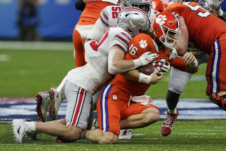 Clemson quarterback Trevor Lawrence is sacked by Ohio State linebacker Pete Werner during the first half of the Sugar Bowl NCAA college football game Friday, Jan. 1, 2021, in New Orleans. (AP Photo/John Bazemore)