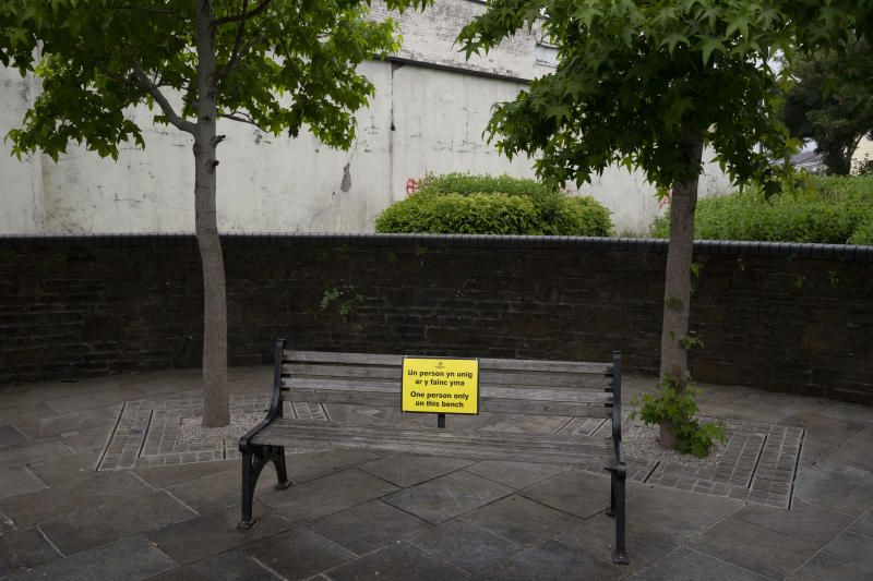 "ABERDARE, UNITED KINGDOM - JUNE 10: A bench with a sign saying ""one person only on this bench"" as part of Rhondda Cynon Taf's social distancing and COVID-19 reduction measures on June 10, 2020 in Aberdare, United Kingdom. The Welsh government has further relaxed COVID-19 lockdown measures this week, allowing people from different households to meet up outside while maintaining social distancing. Schools have remained closed and those who have been advised to shield at home can go outside again but have been told to avoid shopping. (Photo by Matthew Horwood/Getty Images)"