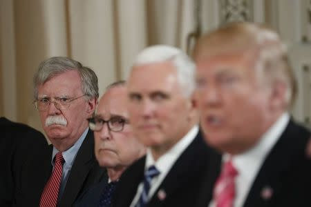 National Security Adviser John Bolton (L) listens as U.S. President Donald Trump speaks while hosting a working luncheon with Japan's Prime Minister Shinzo Abe at Trump's Mar-a-Lago estate in Palm Beach, Florida U.S., April 18, 2018. REUTERS/Kevin Lamarque