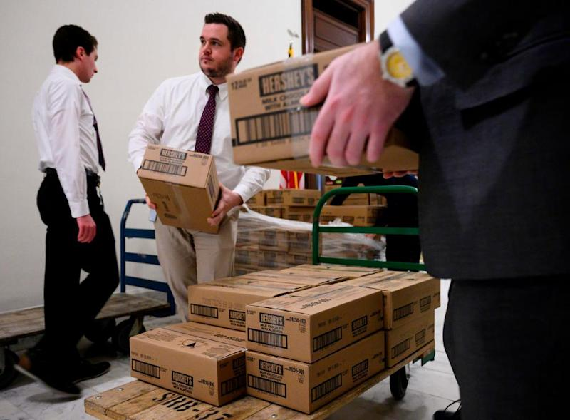 Staff members load boxes of Hershey's candy on to pallets outside of office of Senator Pat Toomey, who is in charge of Senate candy.