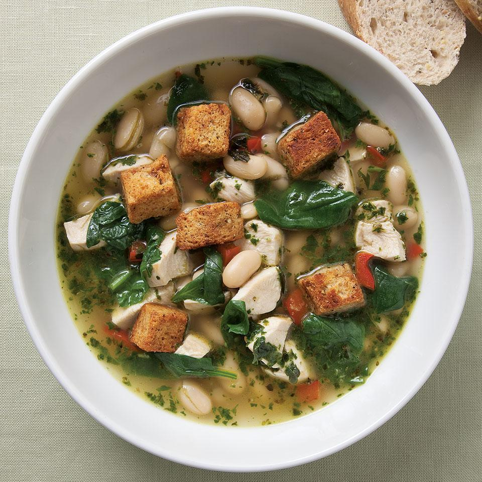 <p>This fragrant, Italian-flavored soup takes advantage of quick-cooking ingredients--boneless, skinless chicken breast, bagged baby spinach and canned beans. It features a simple homemade basil pesto swirled in at the end to add a fresh herb flavor. If you are very pressed for time, you can substitute 3 to 4 tablespoons of a store-bought basil pesto. Recipe by Nancy Baggett for EatingWell.</p>