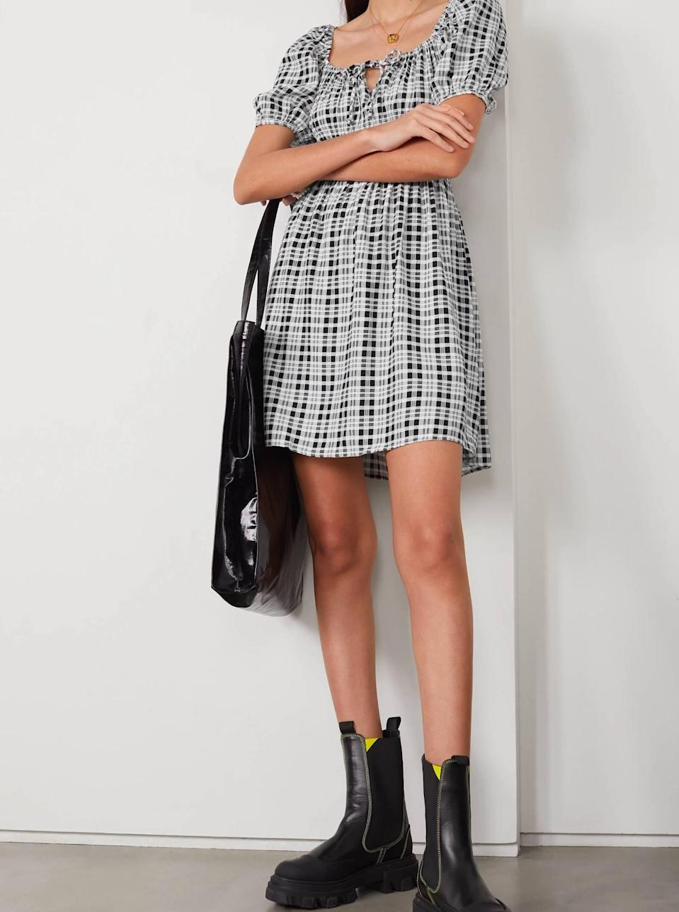 """Even though Faithfull the Brand is known for its frilly, dainty aesthetic—this plaid mini dress is serving approachable grunge vibes we're here for year-round. $169, Net-a-Porter. <a href=""""https://www.net-a-porter.com/en-us/shop/product/faithfull-the-brand/clothing/mini-dresses/-net-sustain-francis-checked-crepe-mini-dress/2204324138977246"""" rel=""""nofollow noopener"""" target=""""_blank"""" data-ylk=""""slk:Get it now!"""" class=""""link rapid-noclick-resp"""">Get it now!</a>"""