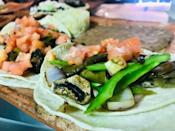 """<p>If you're worried about finding something for your vegan and vegetarian friends at this restaurant, don't be! The owners of <a href=""""http://lasantisimagourmet.com/index.html"""" rel=""""nofollow noopener"""" target=""""_blank"""" data-ylk=""""slk:La Santisima Gourmet Taco Shop"""" class=""""link rapid-noclick-resp"""">La Santisima Gourmet Taco Shop</a> have expanded their taco menu to include vegetarian and vegan options. </p><p><em>Check out <a href=""""https://www.facebook.com/La-Santisima-Gourmet-Taco-Shop-117406708277370/"""" rel=""""nofollow noopener"""" target=""""_blank"""" data-ylk=""""slk:La Santisima Gourmet Taco Shop on Facebook"""" class=""""link rapid-noclick-resp"""">La Santisima Gourmet Taco Shop on Facebook</a>.</em></p>"""