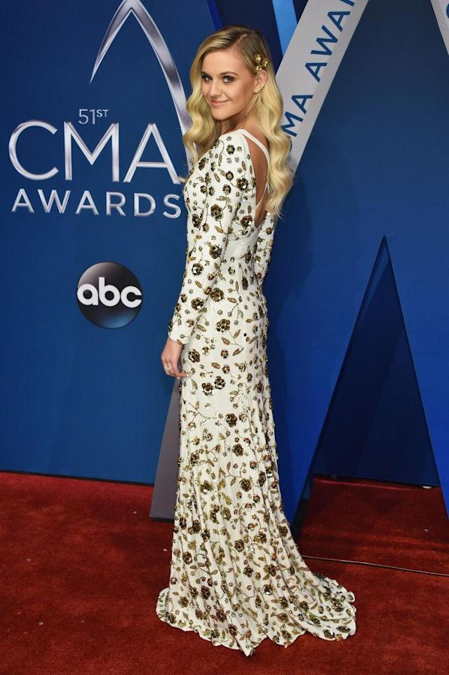 <p>Ballerini rocked a double-cutout dress, featuring an open back and a triangle cut at the abdomen. (Photo: Getty Images) </p>