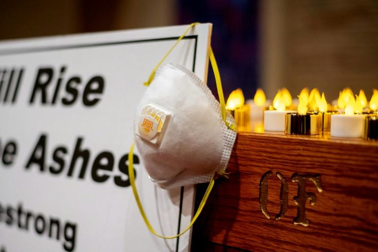 """""""We will rise from the ashes,"""" said a sign on the altar at the church vigil for fire victims in Chico, California"""