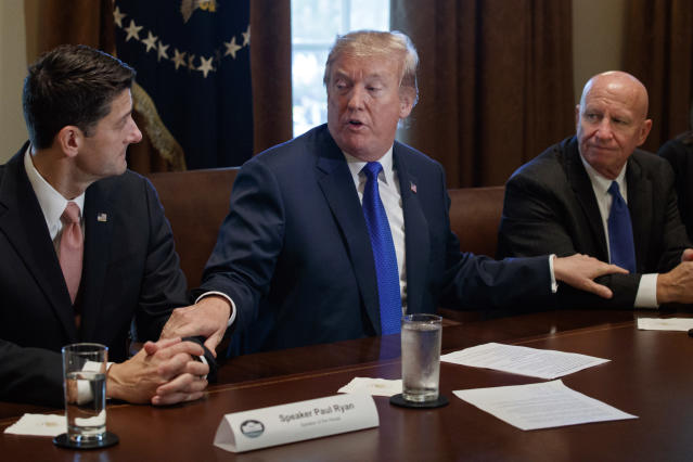 President Donald Trump speaks during a meeting on tax policy with Republican lawmakers in the Cabinet Room of the White House in Washington, with House Speaker Paul Ryan of Wis., and Chairman of the House Ways and Means Committee Rep. Kevin Brady, R-Texas, right. (AP Photo/Evan Vucci)