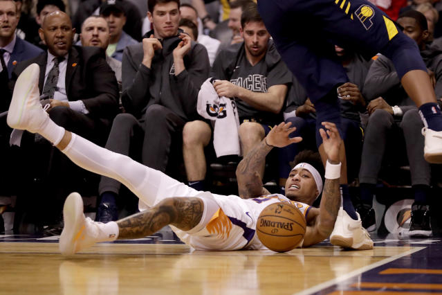 Phoenix Suns forward Kelly Oubre Jr. tries to save the ball from going out of bounds against the Indiana Pacers during the first half of an NBA basketball game, Wednesday, Jan. 22, 2020, in Phoenix. (AP Photo/Matt York)