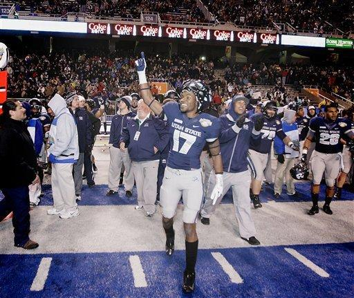Utah State's Jeff Maning (17) celebrates after defeating Toledo in an NCAA college football game on Saturday, Dec. 15, 2012 in Boise, Idaho. Utah State won the Famous Idaho Potato Bowl game 41-15. (AP Photo/Matt Cilley)