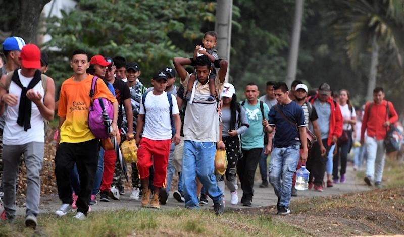 Honduran migrants leave San Pedro Sula heading for the border with Guatemala in April 2019 in the hope of one day reaching the United States (AFP Photo/ORLANDO SIERRA)