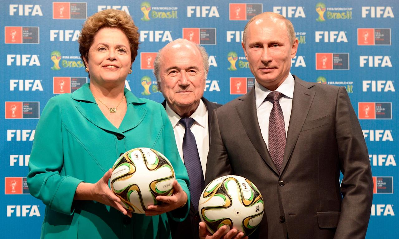 Vladimir Putin, pictured with Sepp Blatter and Brazil's then president Dilma Rousseff, will be delighted that Russia's World Cup bid emerges from Michael Garcia's report untouched.