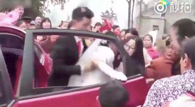 The car is surrounded by wedding guests. Source: Weibo/ Xingzhi Media