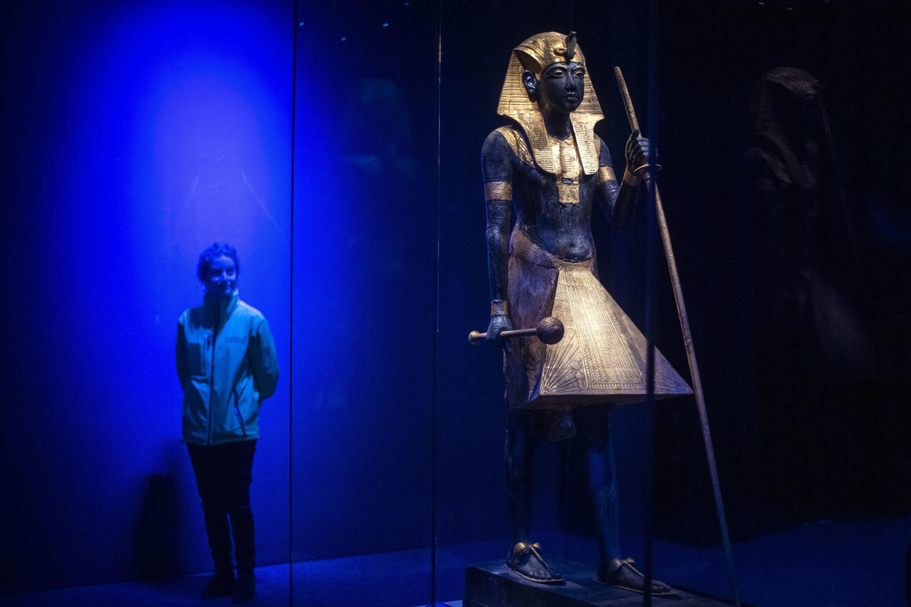 A wooden guardian statue of the king, which flanked the sealed entrance to Tutankhamun's burial chamber (Picture: Getty)