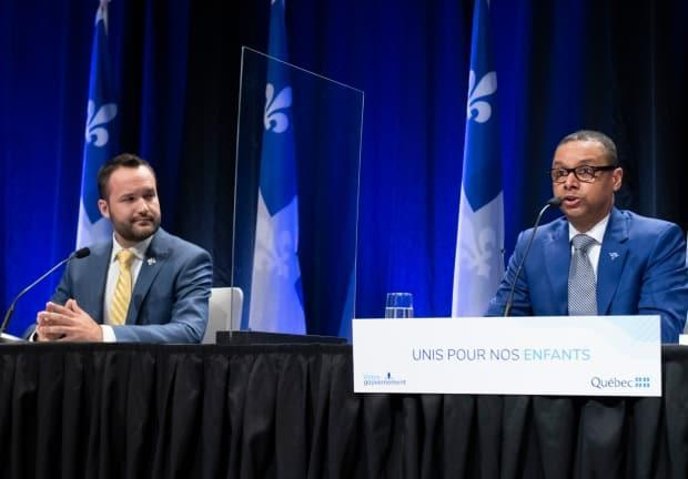 Junior Health Minister Lionel Carmant, right, reacts to a reports on youth, Tuesday, May 4, 2021  in Quebec City. Family Minister Mathieu Lacombe, left, looks on. (Jacques Boissinot/The Canadian Press - image credit)