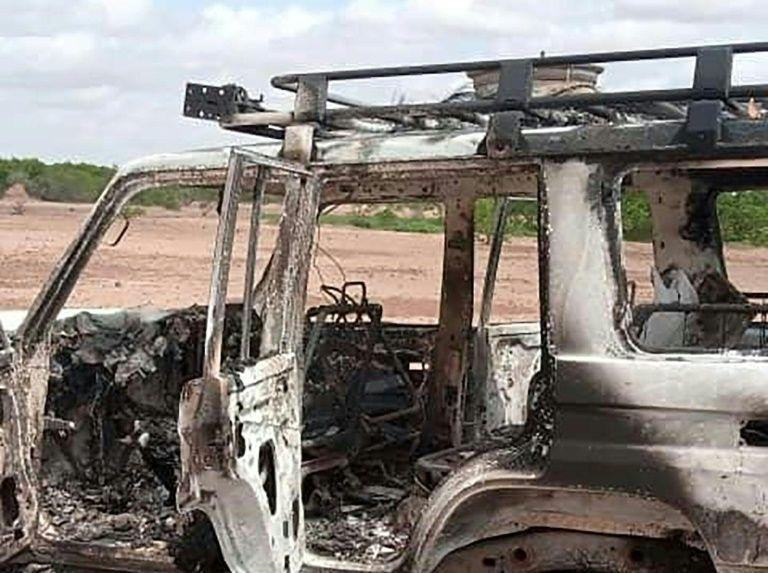 The burnt-out vehicle of eight people, including French aid workers, that was attacked by unidentified gunmen in southwest Niger. Source: AFP