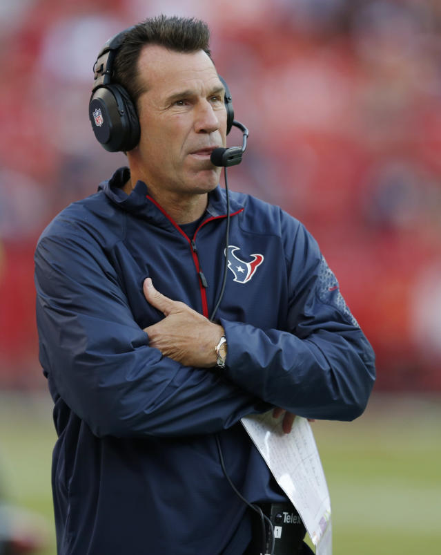 Houston Texans coach Gary Kubiak looks at the scoreboard during the second half of an NFL football game against the Kansas City Chiefs at Arrowhead Stadium in Kansas City, Mo., Sunday, Oct. 20, 2013. (AP Photo/Ed Zurga)