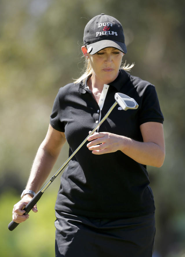Cristie Kerr looks at her putter after missing a birdie putt on the fourth hole during the final round of the Kraft Nabisco Championship golf tournament Sunday, April 6, 2014 in Rancho Mirage, Calif. (AP Photo/Chris Carlson)