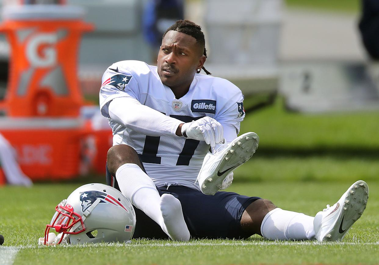 FOXBOROUGH, MA - SEPTEMBER 18: New England Patriots wide receiver Antonio Brown puts on his shoes on the field during New England Patriots practice at Gillette Stadium in Foxborough, MA on Sep. 18, 2019. (Photo by John Tlumacki/The Boston Globe via Getty Images)