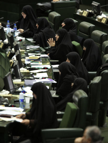 Iranian lawmakers listen to President Mahmoud Ahmadinejad's speech at the parliament in Tehran, Iran, Wednesday, Jan. 16, 2013. Ahmadinejad admitted Wednesday that sanctions have slowed down Iran's growth and disrupted its foreign trade and said the country has to stop relying on oil revenues in state budget to overcome sanctions. (AP Photo/Vahid Salemi)
