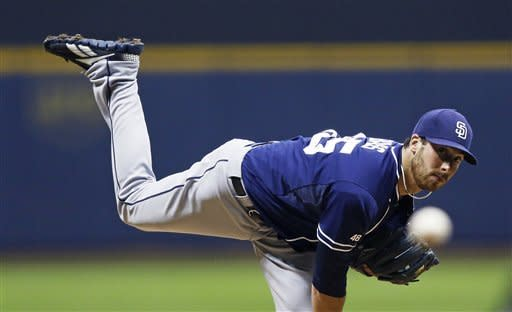 San Diego Padres' Anthony Bass watches a pitch to a Milwaukee Brewers batter during the first inning of a baseball game Tuesday, Oct. 2, 2012, in Milwaukee. (AP Photo/Tom Lynn)