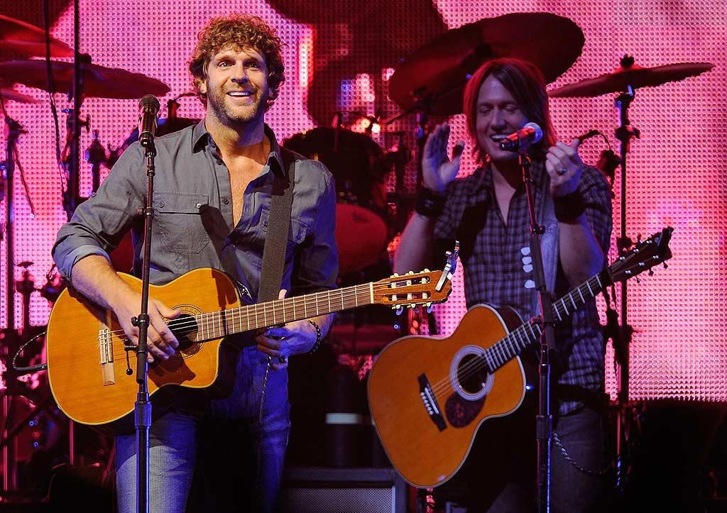 "Also rocking out for fans was ""That's How Country Boys Roll"" singer Billy Currington, who recently said he'd like to be an actor playing roles similar to those of Matthew McConaughey and have a career like that of Kenny Rogers. Do you think that will happen? Frederick Breedon/<a href=""http://www.gettyimages.com/"" target=""new"">GettyImages.com</a> - October 5, 2010"