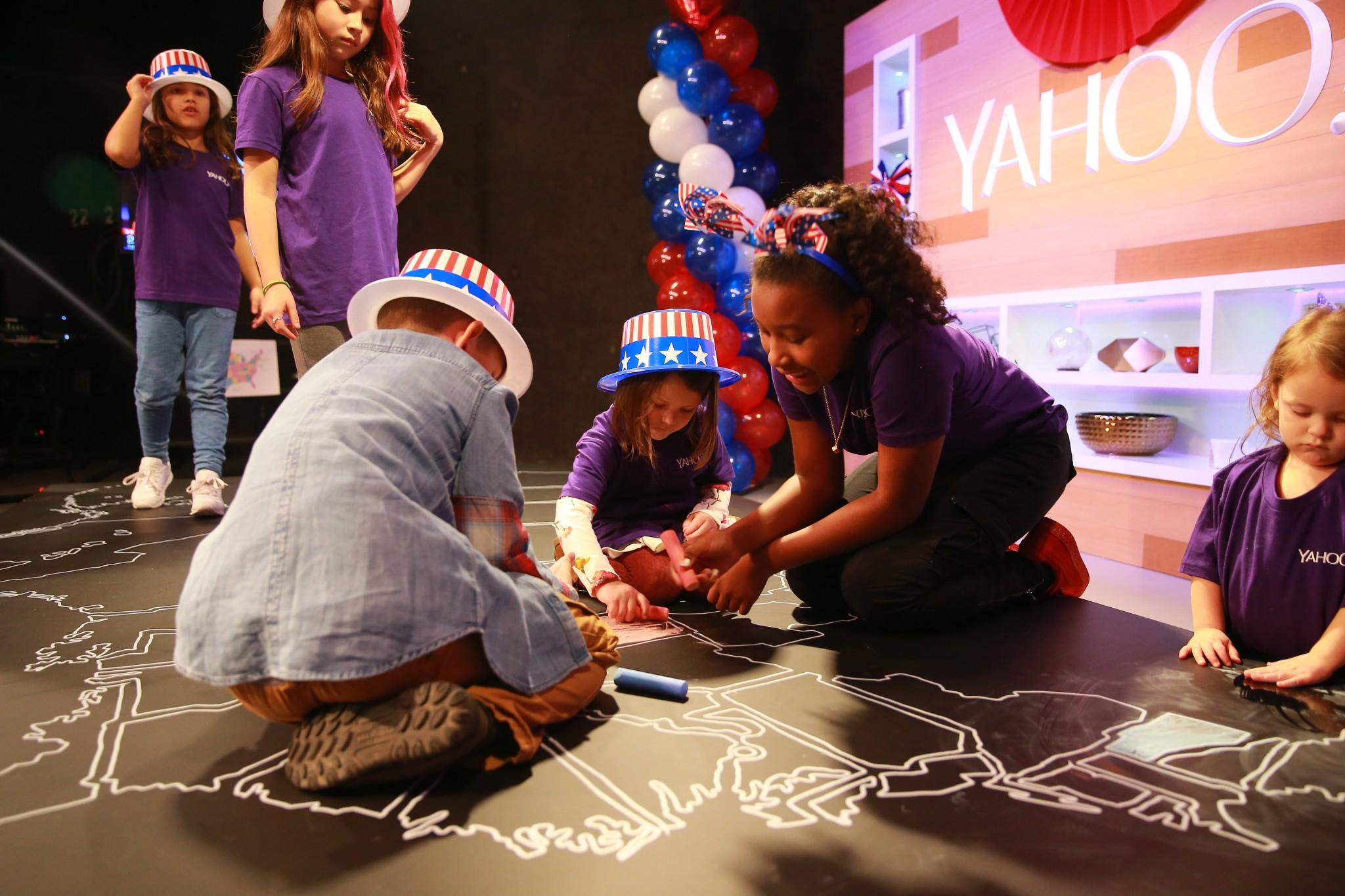 The children of Yahoo staff members and their guests color in the electoral map at the Yahoo News Studios on Tuesday, Nov. 8, 2016. (Photo: Gordon Donovan/Yahoo News)