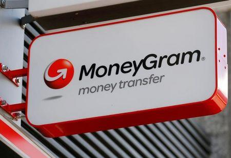 FILE PHOTO - A Moneygram logo is seen outside a bank in Vienna