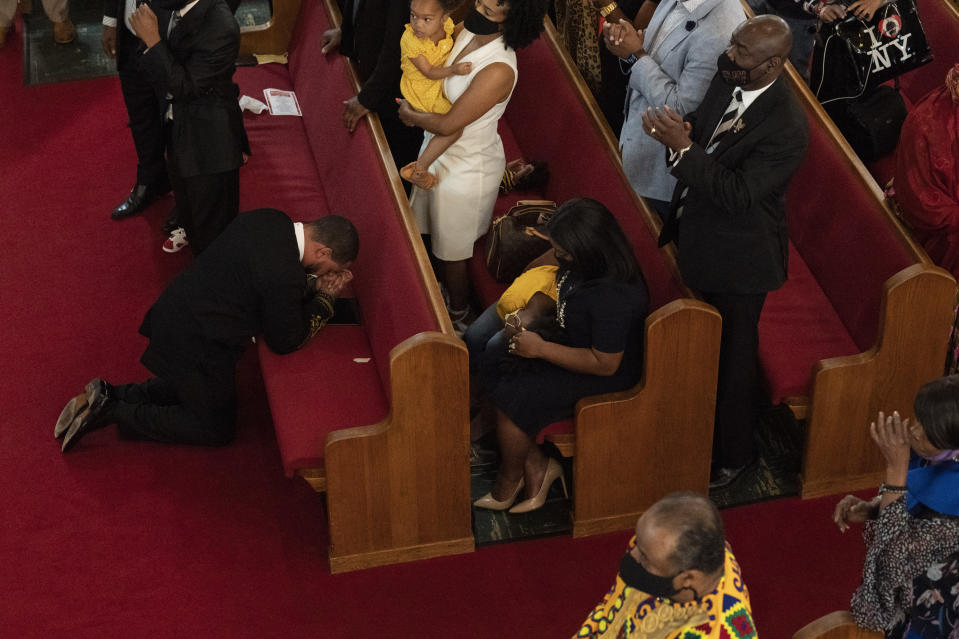 Rev. John R. Faison, Sr. kneels in prayer after preaching at a joint service for the centennial of the Tulsa Race Massacre at First Baptist Church of North Tulsa, Sunday, May 30, 2021, in Tulsa, Okla. (AP Photo/John Locher)