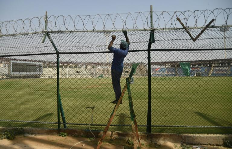 A labourer constructs a security fence at the National Cricket Stadium in Karachi ahead of staging the final of the Pakistan Super League on March 25