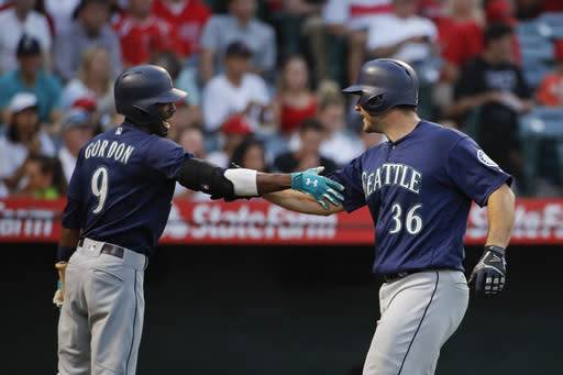 Seattle Mariners' David Freitas, right, celebrates his home run with Dee Gordon during the third inning of a baseball game against the Los Angeles Angels, Wednesday, July 11, 2018, in Anaheim, Calif. (AP Photo/Jae C. Hong)
