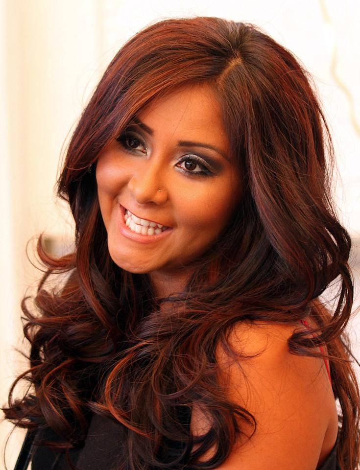 "Snooki had an unlikely ally in former Presidential candidate John McCain this week. After complaining about the Obama administration's proposed 10% tax on indoor tanning, the orange-hued ""Jersey Shore"" starlet received a tweet from McCain Wednesday, saying, ""U r right, I would never tax your tanning bed! Pres Obama's tax/spend policy is quite The Situation. but I do rec wearing sunscreen!"" Jean Baptiste Lacroix/<a href=""http://www.wireimage.com"" target=""new"">WireImage.com</a> - June 6, 2010"