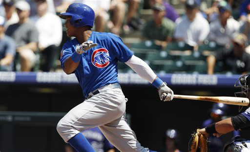 Chicago Cubs' Starlin Castro follows the flight of his single against the Colorado Rockies in the first inning of a baseball game in Denver, Sunday, July 21, 2013. (AP Photo/David Zalubowski)