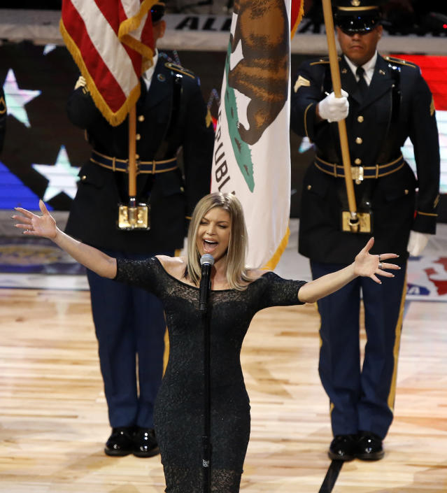 Fergie belts out the national anthem before the NBA All-Star Game in Los Angeles on Feb. 18, 2018. (AP Photo/Alex Gallardo)