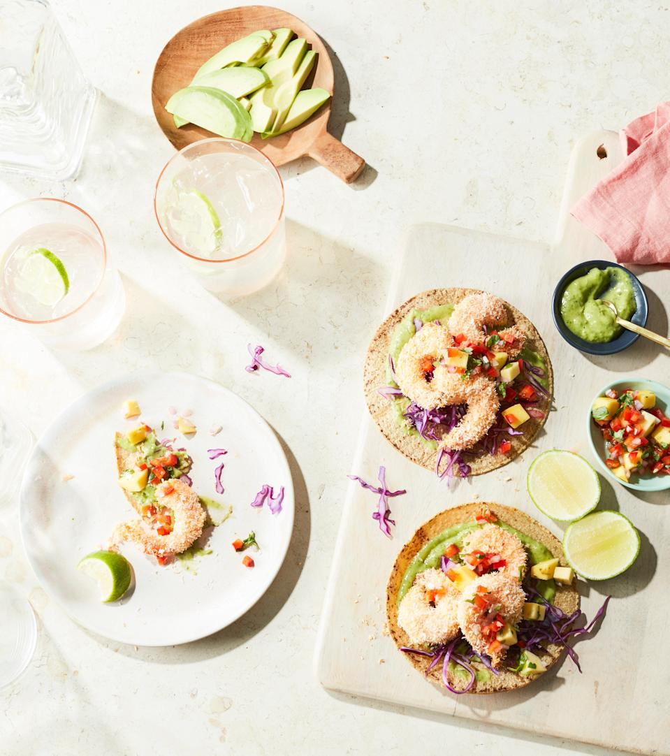 """This dish looks and tastes so impressive, but it's actually pretty simple to make. The cilantro avocado sauce is delectable, and would also work well drizzled over nachos or quesadillas. <a href=""""https://www.epicurious.com/recipes/food/views/coconut-shrimp-tacos-with-mango-salsa-and-avocado-cilantro-sauce?mbid=synd_yahoo_rss"""" rel=""""nofollow noopener"""" target=""""_blank"""" data-ylk=""""slk:See recipe."""" class=""""link rapid-noclick-resp"""">See recipe.</a>"""