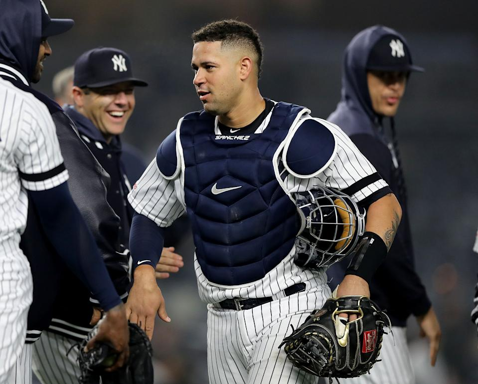 NEW YORK, NEW YORK - MAY 03:  Gary Sanchez #24 of the New York Yankees celebrates the win with teammates after the game against the Minnesota Twins at Yankee Stadium on May 03, 2019 in the Bronx borough of New York City.The New York Yankees defeated the Minnesota Twins 6-3. (Photo by Elsa/Getty Images)