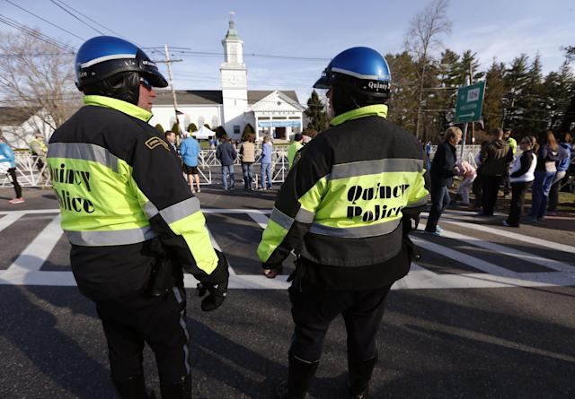 Quincy, Mass., police stand near the starting line of the 118th Boston Marathon Monday, April 21, 2014 in Hopkinton, Mass. (AP Photo/Michael Dwyer)