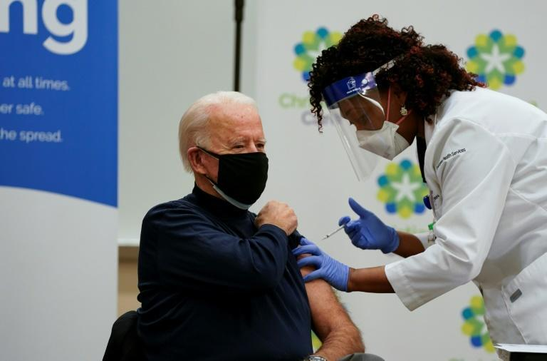 US President-elect Joe Biden receives a Covid-19 vaccination from Tabe Masa, Nurse Practitioner, at the Christiana Care hospital in Newark, Delaware