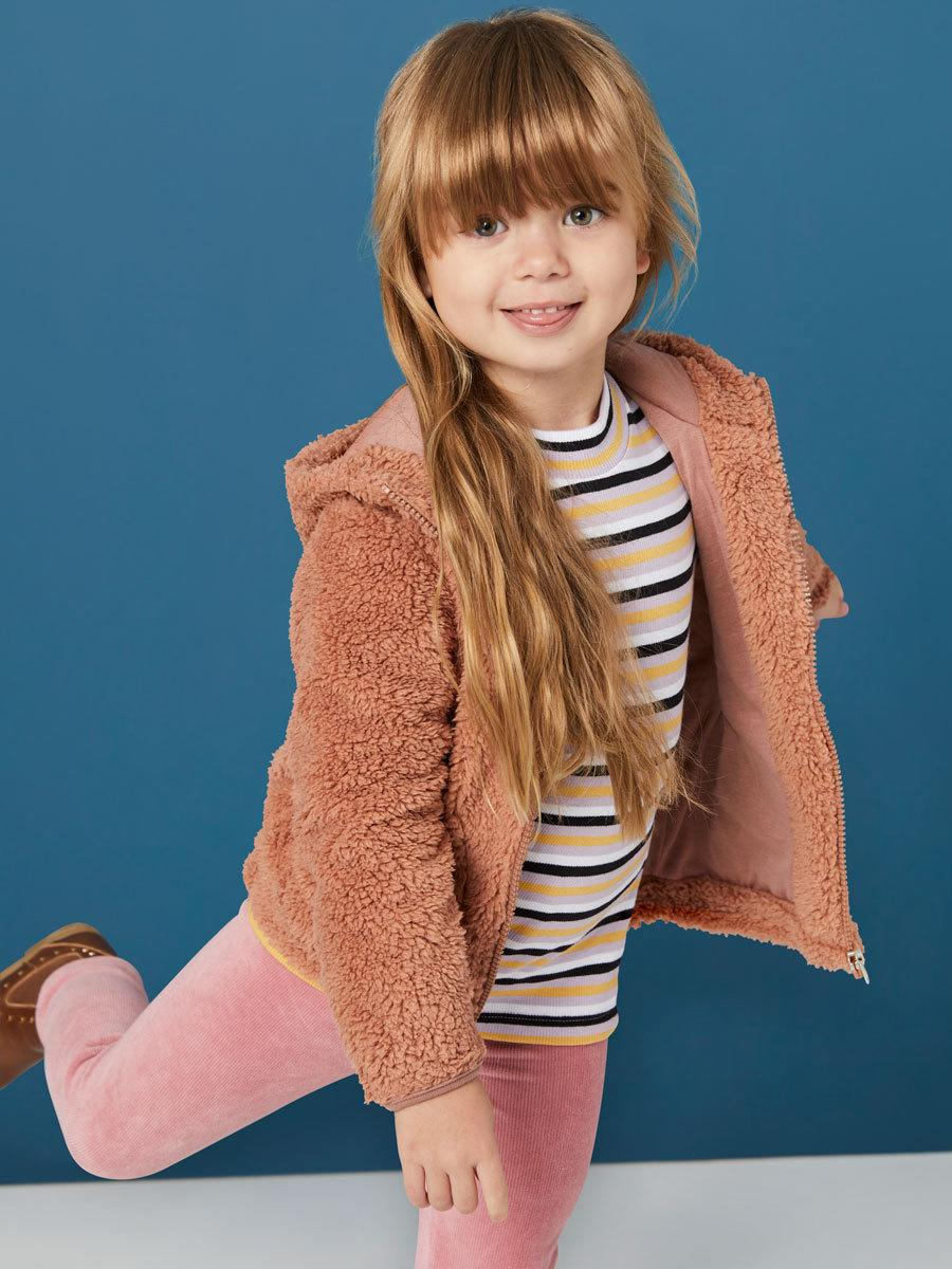 Red-haired child girl wears Best & Less Teddy Bomber jacket $15