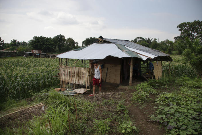 Ronnel Manjares walks outside his house in Tanauan, Batangas province, Philippines, Wednesday, July 15, 2020. His 16-day-old son Kobe Manjares was heralded as the country's youngest COVID-19 survivor. But the relief and joy proved didn't last. Three days later, Kobe died on June 4 from complications of Hirschsprung disease, a rare birth defect. (AP Photo/Aaron Favila)
