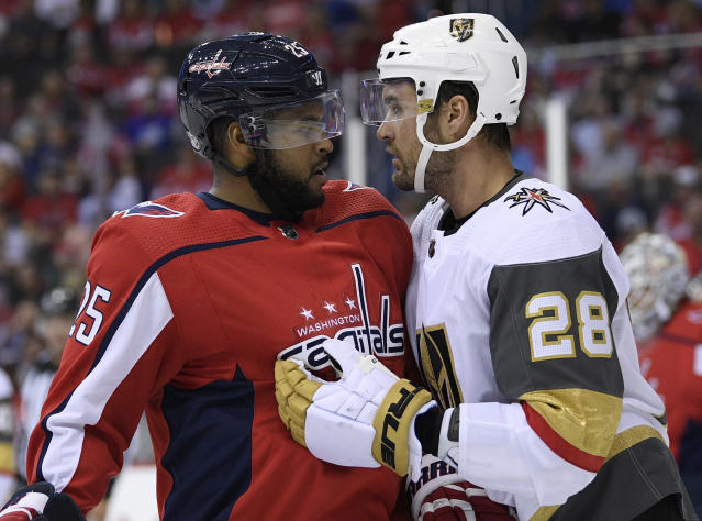 Washington Capitals right wing Devante Smith-Pelly (25) and Vegas Golden Knights left wing William Carrier (28) exchange words during the first period of an NHL hockey game Wednesday, Oct. 10, 2018, in Washington. (AP Photo/Nick Wass)