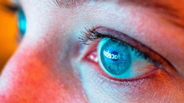 PHOTO: The Facebook logo is reflected in the eye of a woman viewing a computer display in Mill Valley, Calif., March 21, 2018. (Josh Edelson/AFP via Getty Images, FILE)