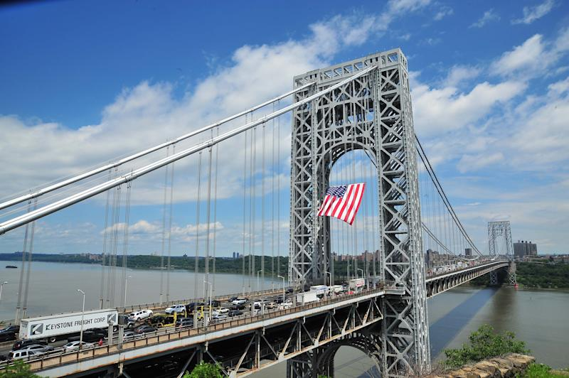 In this photo provided by the Port Authority of New York and New Jersey, a large American flag waves in the breeze as it hangs from the superstructure of the George Washington Bridge in New York, Friday, June 14, 2013, in observance of Flag Day. According to the Port Authority, the flag is one of the world's largest free-flying flags. (AP Photo/Port Authority of New York and New Jersey)