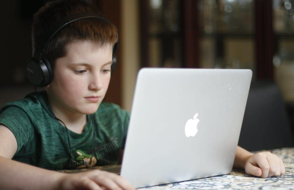 """<span class=""""caption"""">Thomas Reevely, 10, takes part in a class meeting in Ottawa, April 3, 2020. </span> <span class=""""attribution""""><span class=""""source"""">THE CANADIAN PRESS/David Reevely</span></span>"""